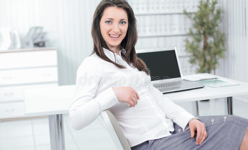 Smiling employee sitting at a Desk in the office. Photo with copy space stock photo
