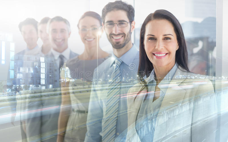 Smiling employees in a line royalty free stock image