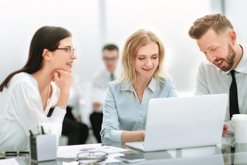 Smiling employees sitting at the office Desk stock photos