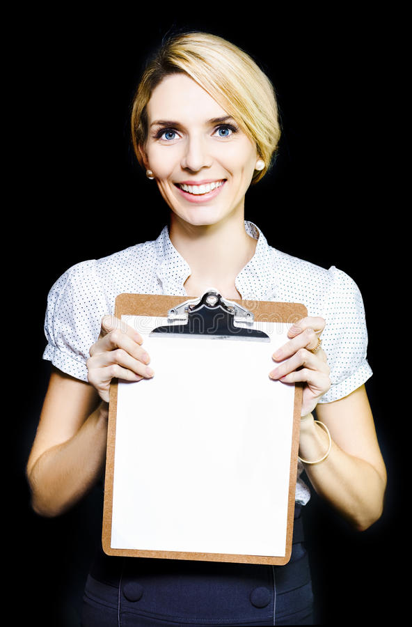 Download Smiling Enthusiastic Woman Holding Blank Clipboard Stock Photo - Image: 24616176