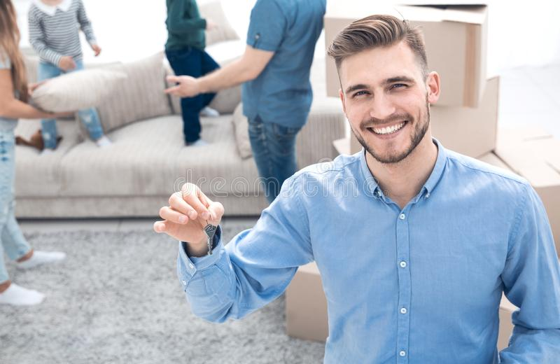 Smiling estate agent showing keys from new apartments stock photos