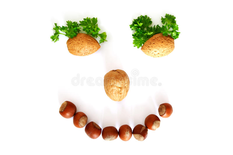 Smiling face. Is made whith help of nuts stock photography