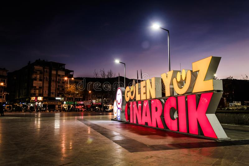Smiling Face Of Cinarcik Logo In Town Square. The positive tag line that describes the small summer town named Cinarcik located in Marmara region of the country stock photos