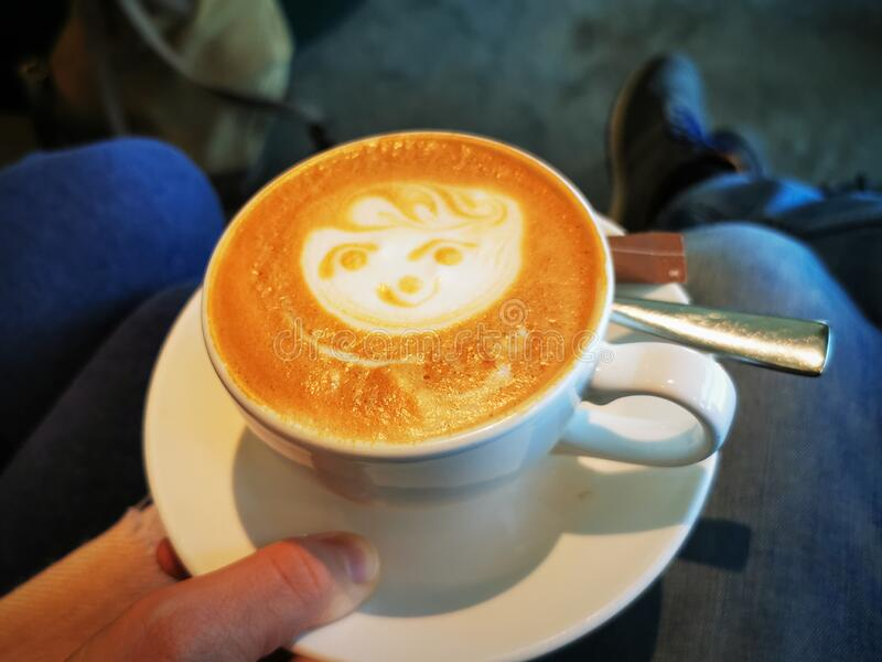 Face in cappuccino froth stock photography