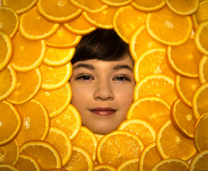 The face of a Child in oranges royalty free stock images