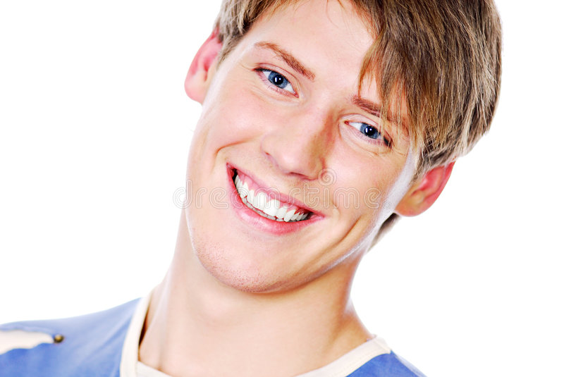 Smiling face of handsome teenager stock photography