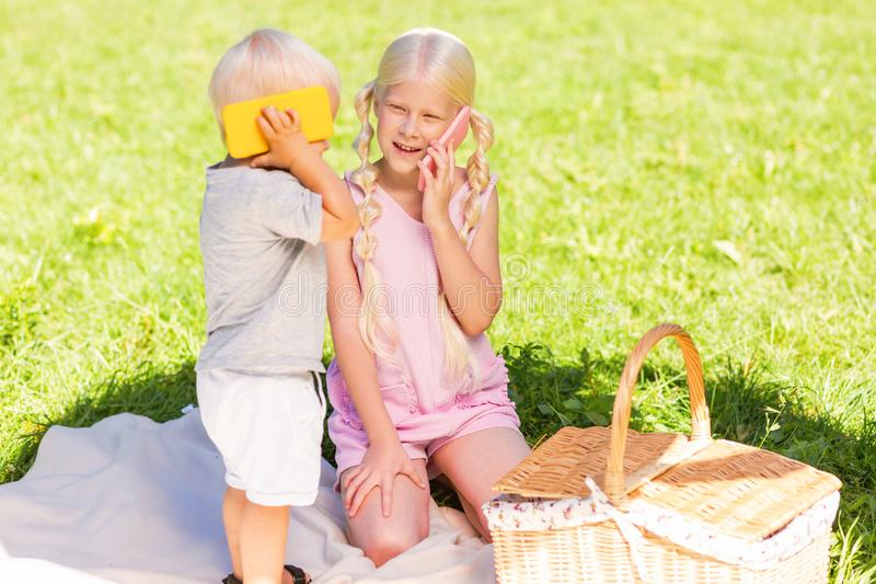 Happy cheerful kids playing in the park together royalty free stock images