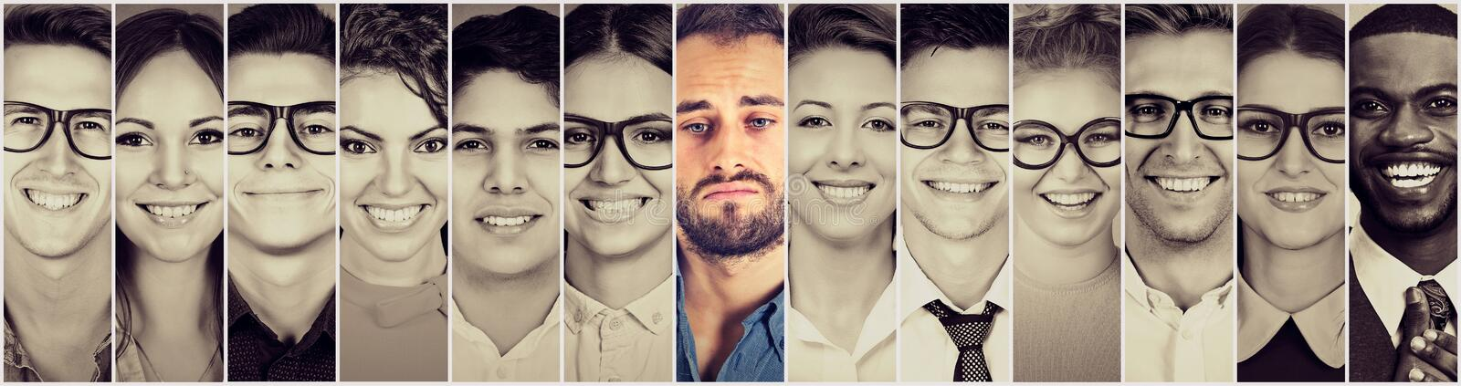 Smiling faces. Happy group of multiethnic people men and women. And a sad man royalty free stock images