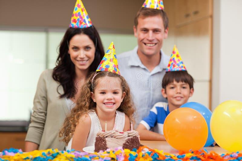 Smiling family celebrating birthday royalty free stock photos