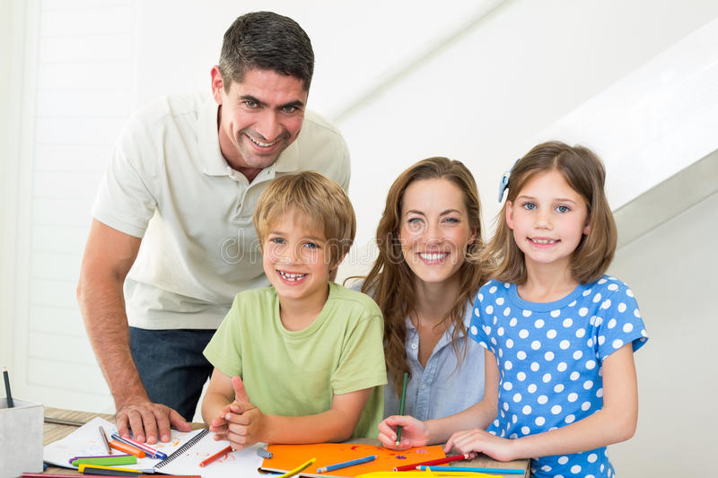 Smiling family coloring at home royalty free stock image