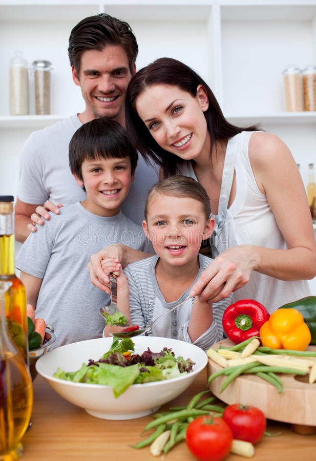 Download Smiling Family Cooking Together Stock Photo - Image: 11997018