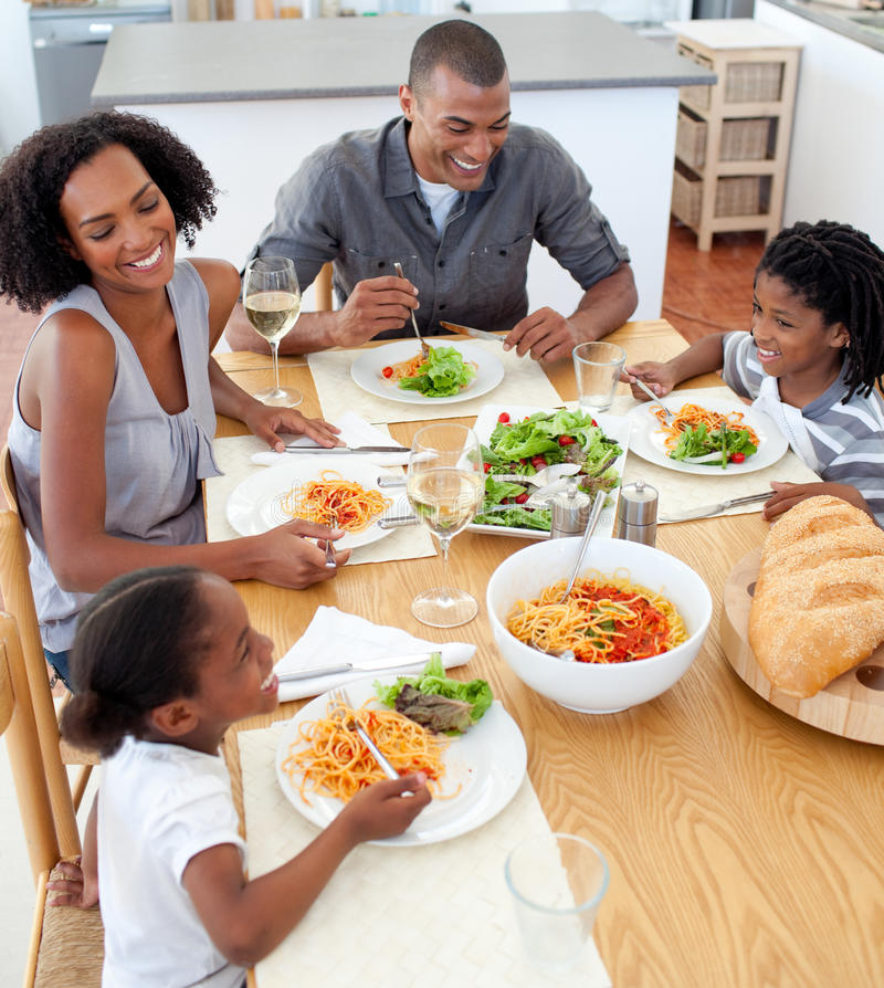 Smiling family dining together. In the kitchen royalty free stock images