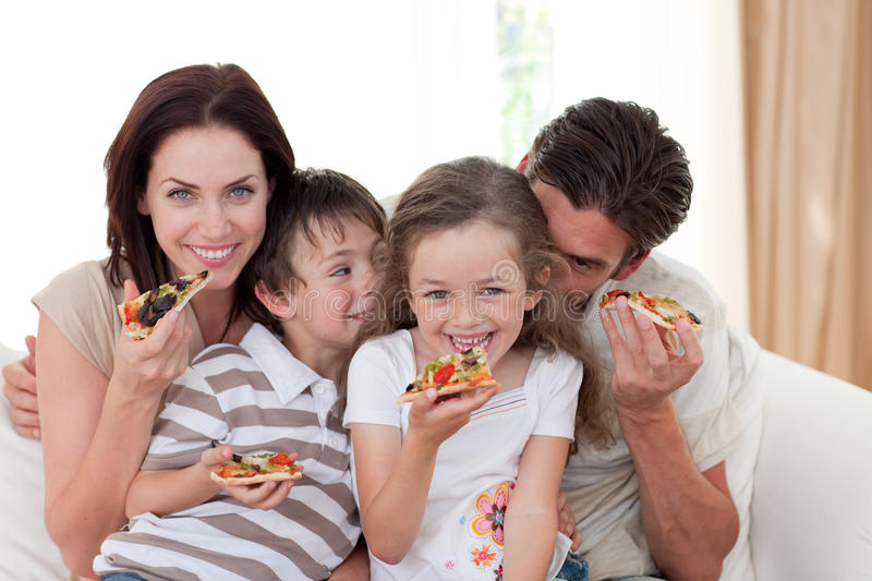 Download Smiling Family Eating Pizza Stock Photo - Image: 11996762