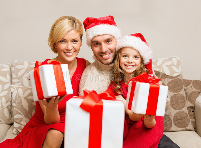Download Smiling Family Giving Many Gift Boxes Stock Photo - Image: 35224452