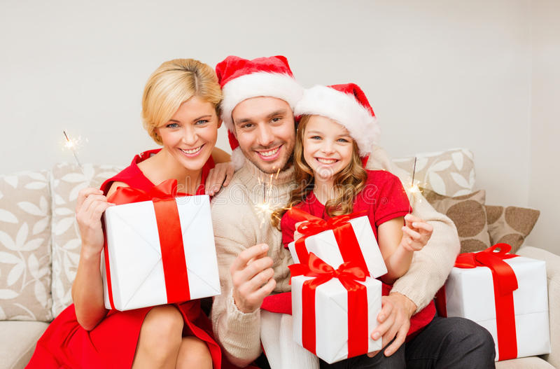 Download Smiling Family Holding Gift Boxes And Sparkles Stock Photo - Image: 35225494