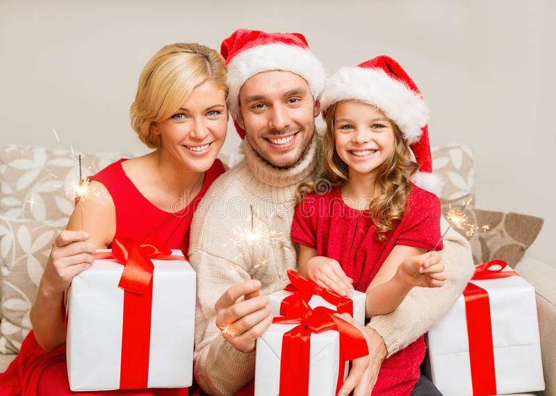 Download Smiling Family Holding Gift Boxes And Sparkles Stock Image - Image: 35225619