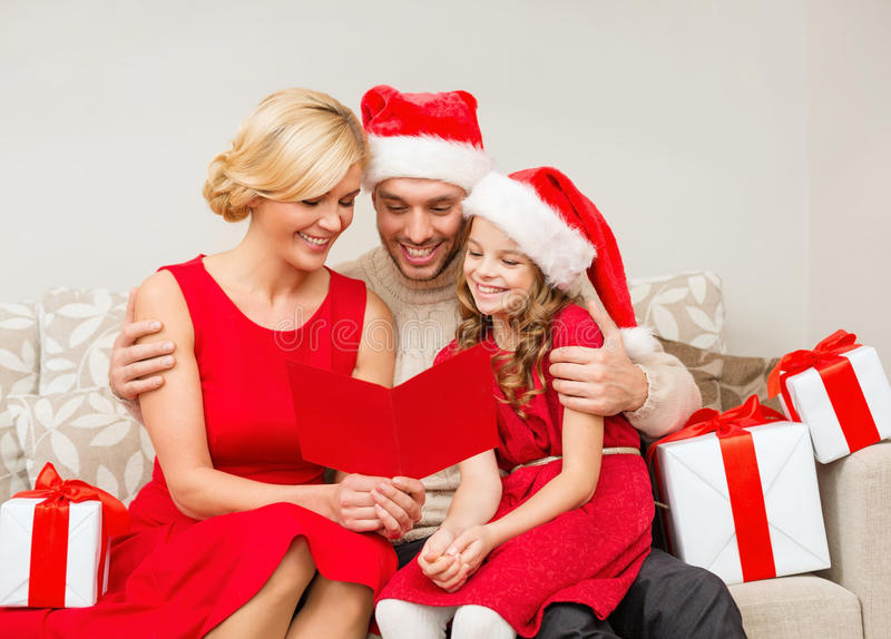 Download Smiling Family Reading Postcard Stock Image - Image: 35224349
