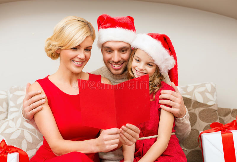 Smiling Family Reading Postcard Stock Photography