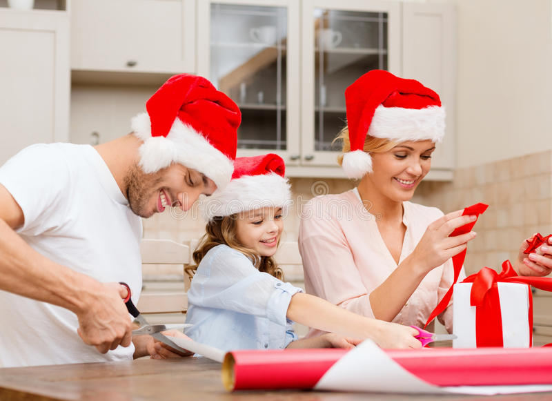 Download Smiling Family In Santa Helper Hats With Gift Box Stock Photo - Image: 35225580
