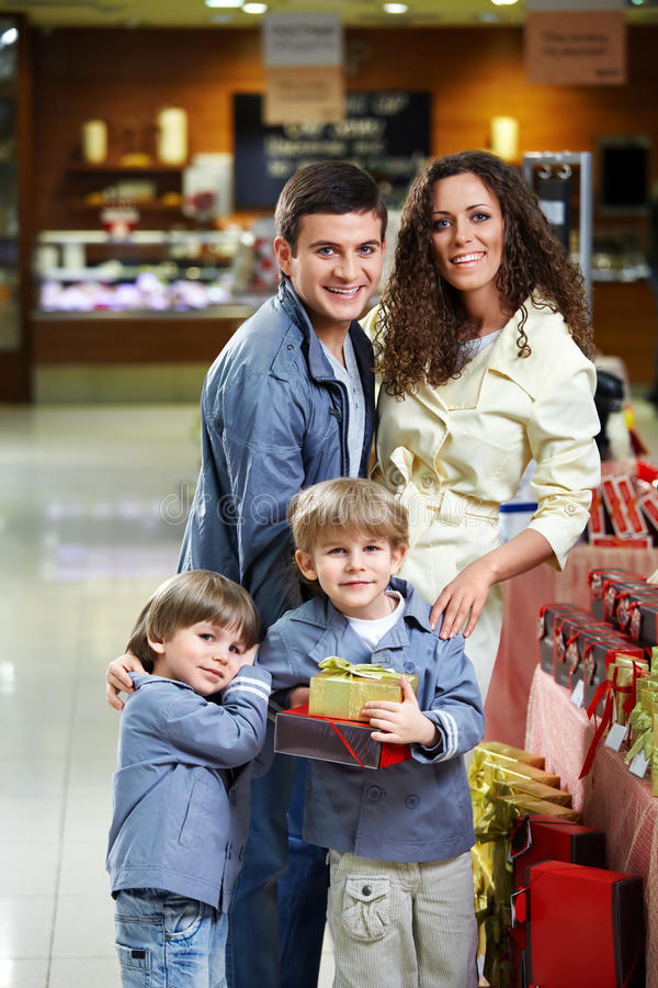 Smiling family in shop stock photos