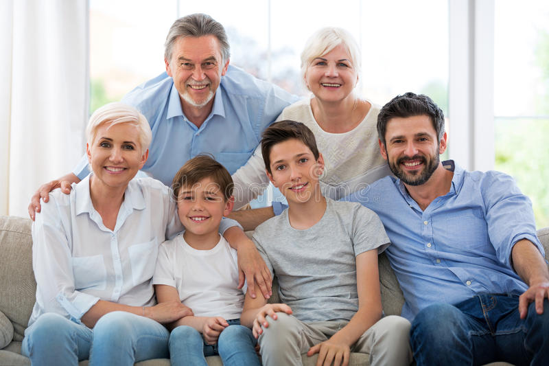 Smiling family on sofa. Family of three generations relaxing on sofa royalty free stock photo