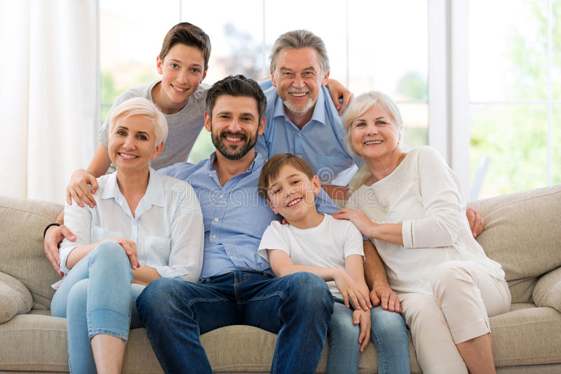 Smiling family on sofa. Family of three generations relaxing on sofa royalty free stock photos