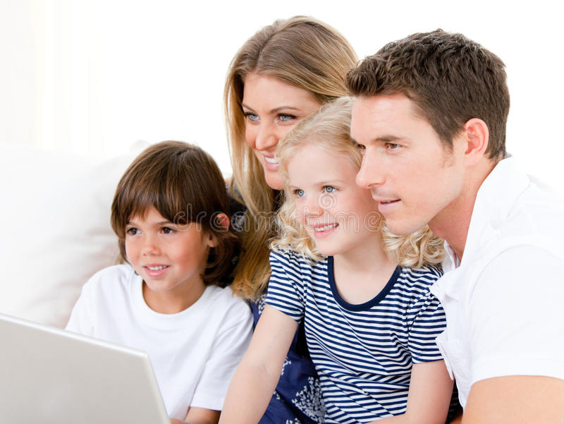 Smiling family surfing on internet. Against a white background stock images