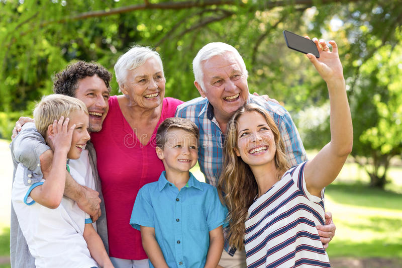 Smiling family taking selfie. In the garden royalty free stock photos