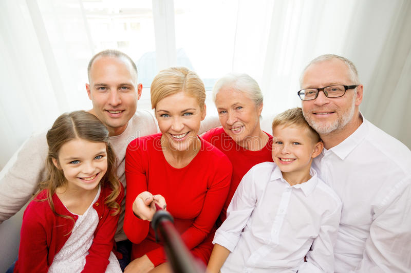Smiling family taking selfie at home stock image