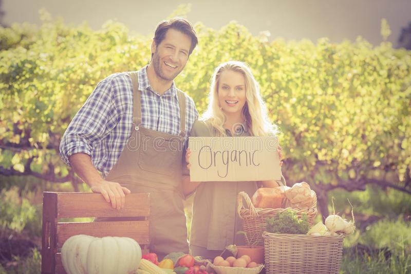 Smiling farmers couple looking at the camera stock images