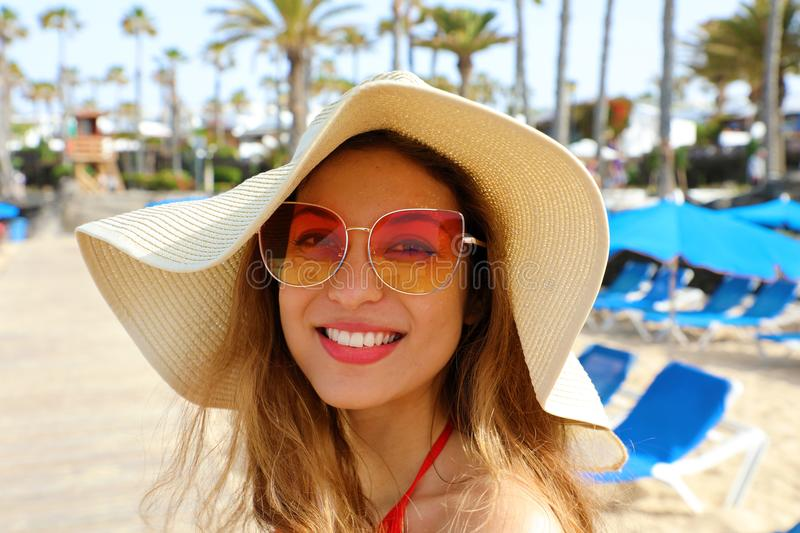 Smiling fashion girl on the beach. Young woman with straw hat and sunglasses in her summer holidays at Canary Islands stock photography
