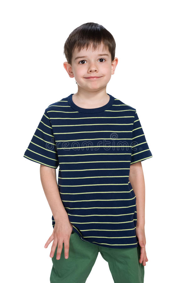 Smiling fashion little boy stands stock photos