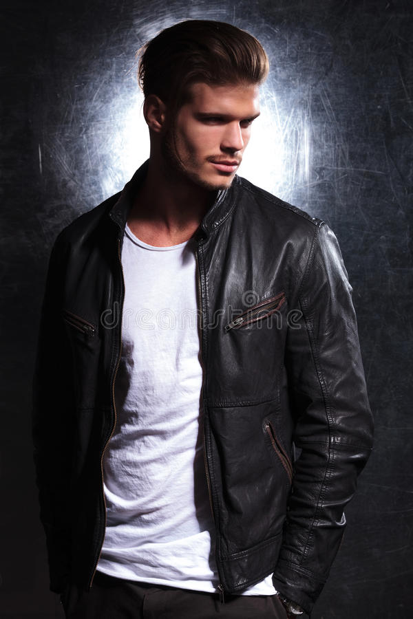 Smiling fashion man wearing a leather jacket stock photography