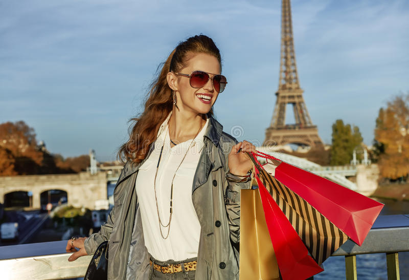 Smiling fashion-monger looking into distance in Paris, France stock image