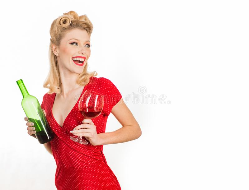Smiling fashionable pinup girl. Beauty trends. Beauty. Happy girl with glass of wine. Beautiful blonde woman in red royalty free stock photo