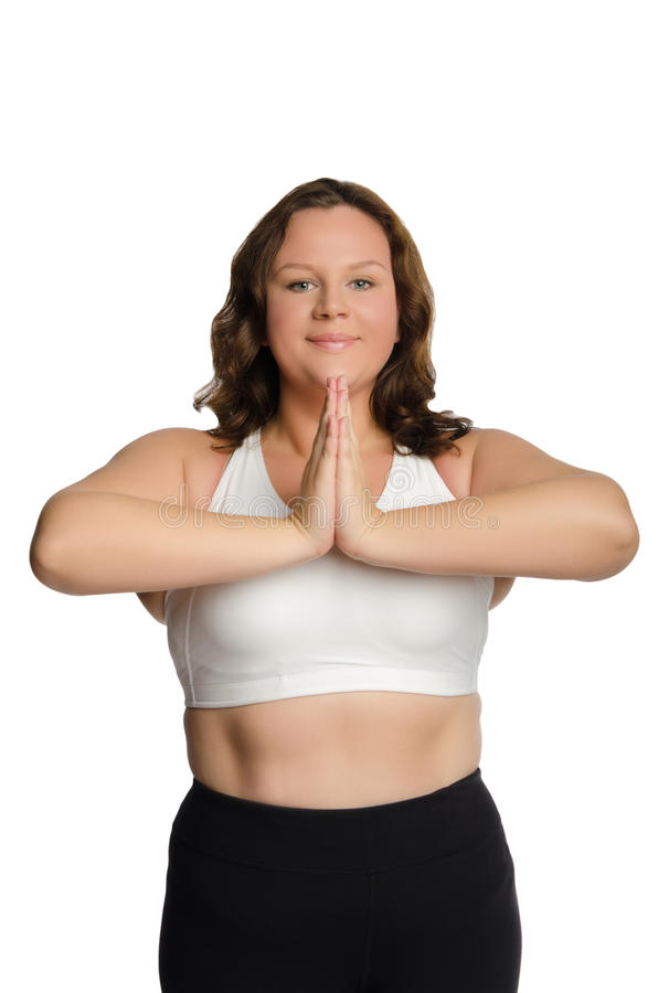 Smiling fat woman is engaged in fitness stock image