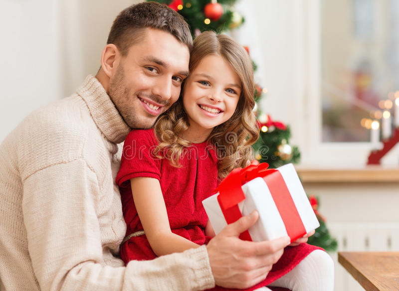 Download Smiling Father And Daughter Holding Gift Box Stock Photo - Image: 35320486