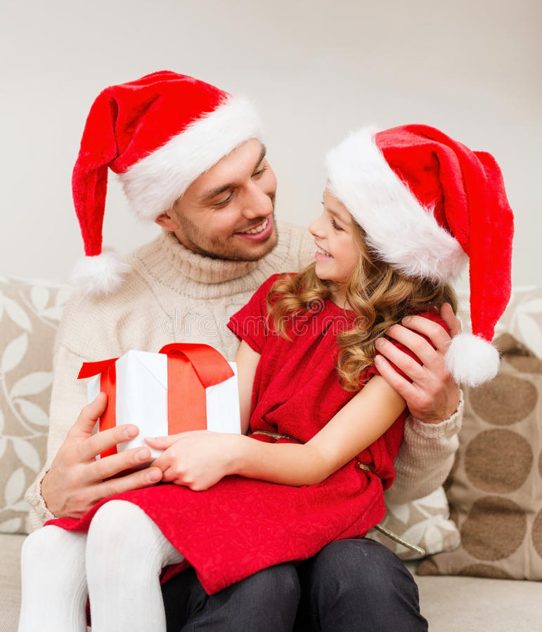 Download Smiling Father And Daughter Holding Gift Box Stock Photography - Image: 35224192