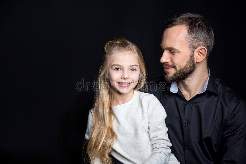 Smiling father and daughter stock photos