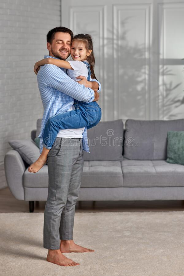 Free Smiling Father Hugging His Cute Little Child Daughter. Stock Photo - 221402930