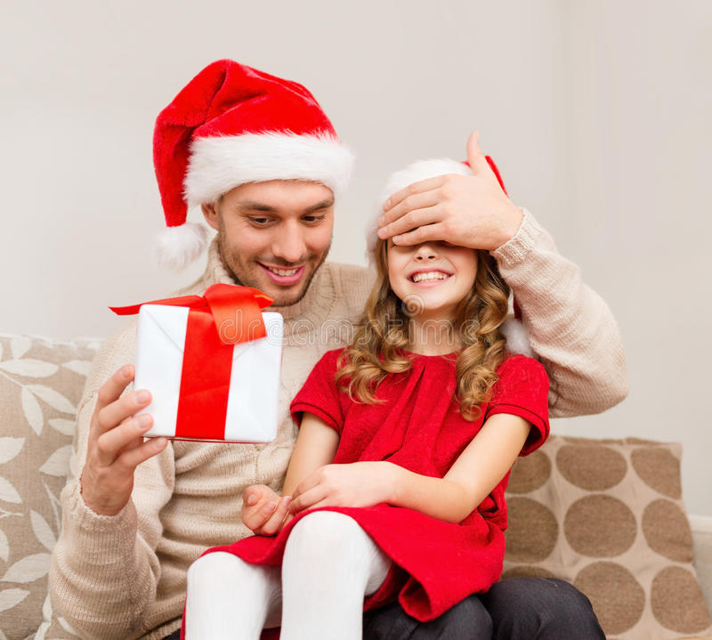 Download Smiling Father Surprises Daughter With Gift Box Stock Photo - Image: 35225376