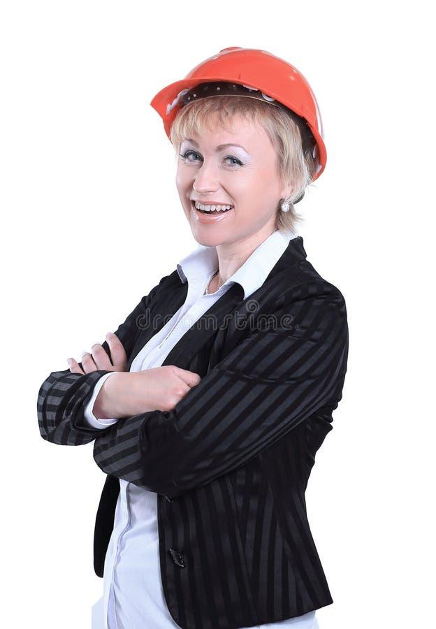Smiling female architect in the orange helmet.isolated on white royalty free stock images