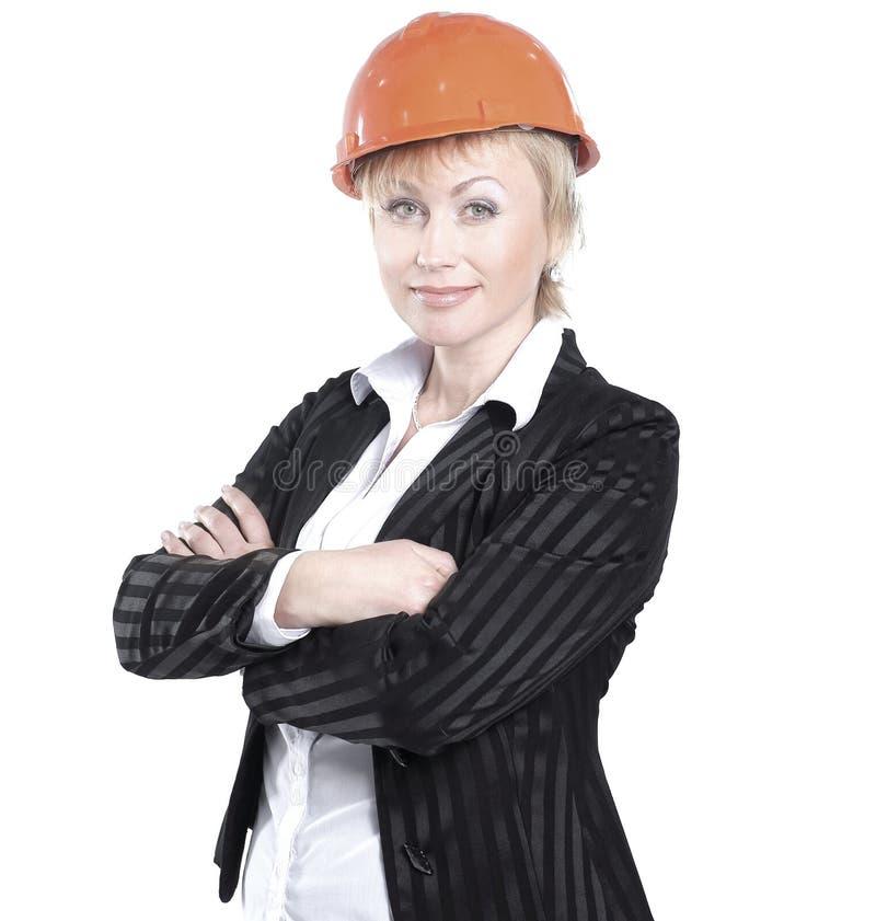 Smiling female architect in the orange helmet.isolated on white royalty free stock photos