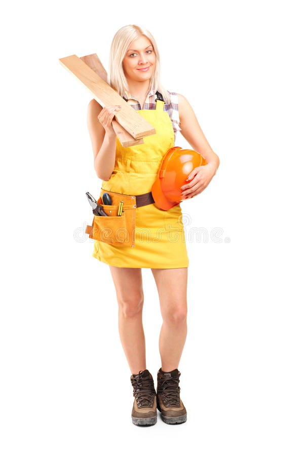 Download Smiling Female Carpenter Holding Sills And Helmet Stock Image - Image: 24862747