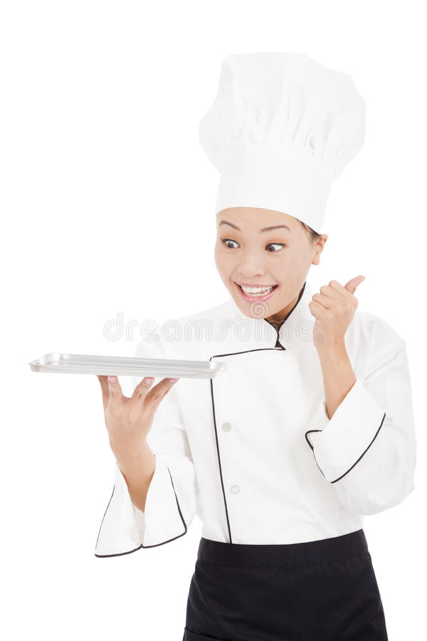 Smiling female chef, cook or baker showing thumbs up. On white stock image