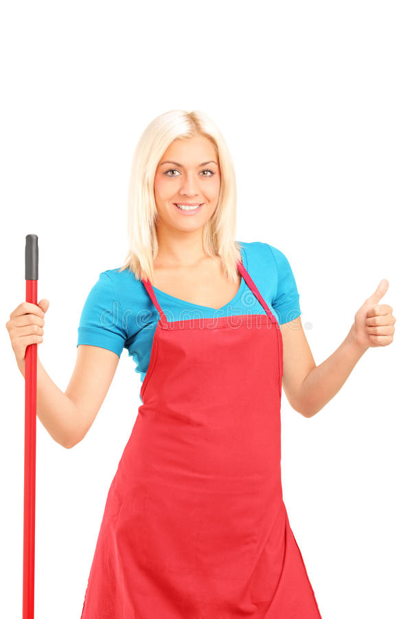 Smiling Female Cleaner Giving A Thumb Up Royalty Free Stock Photos