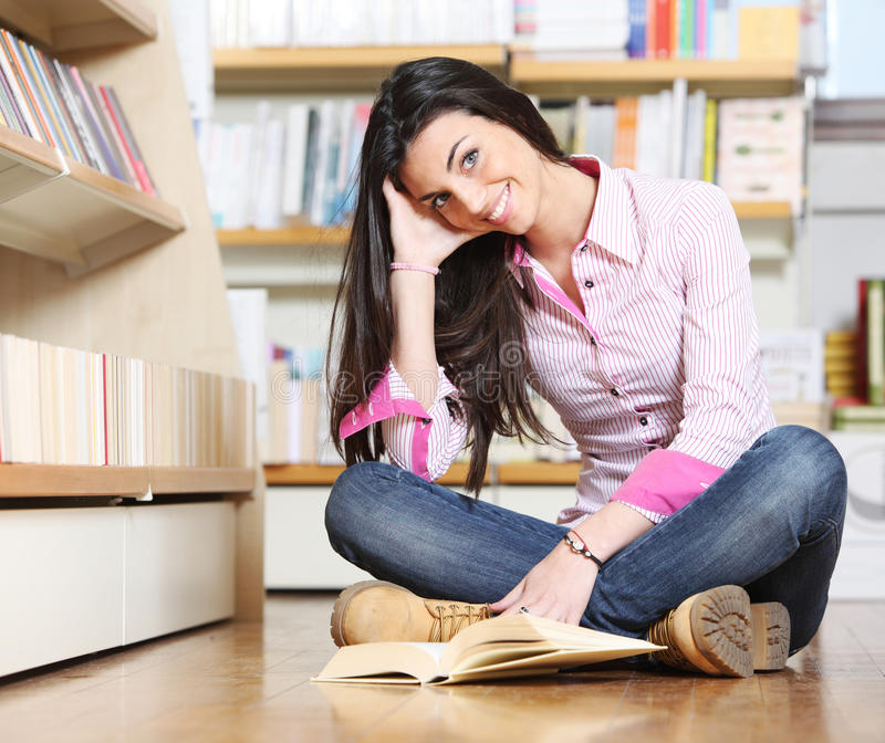 Smiling female college student stock photography