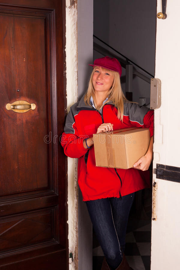 Smiling Female Courier royalty free stock image