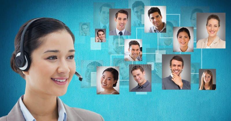 Smiling female customer care representative wearing headphones against flying portraits stock photos