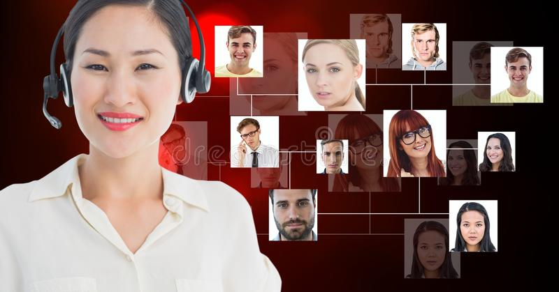 Smiling female customer care representative wearing microphone against flying business portraits stock photos